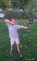 child shooting a bow