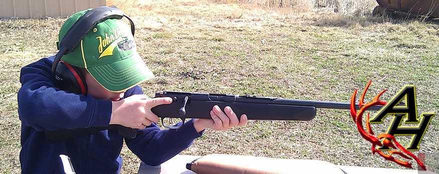 children kids learning to shoot guns