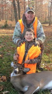 youth deer hunter with grandpa